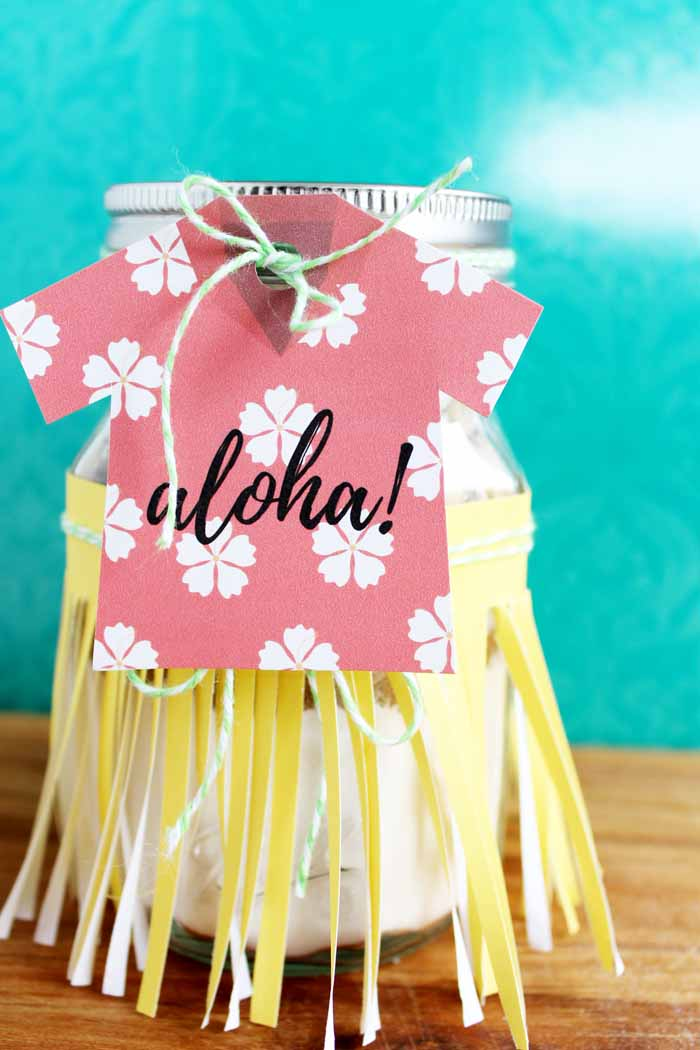 Make a cookies in a jar gift is perfect for any occasion! Get the free printable tags as well as the recipe for aloha cookies!