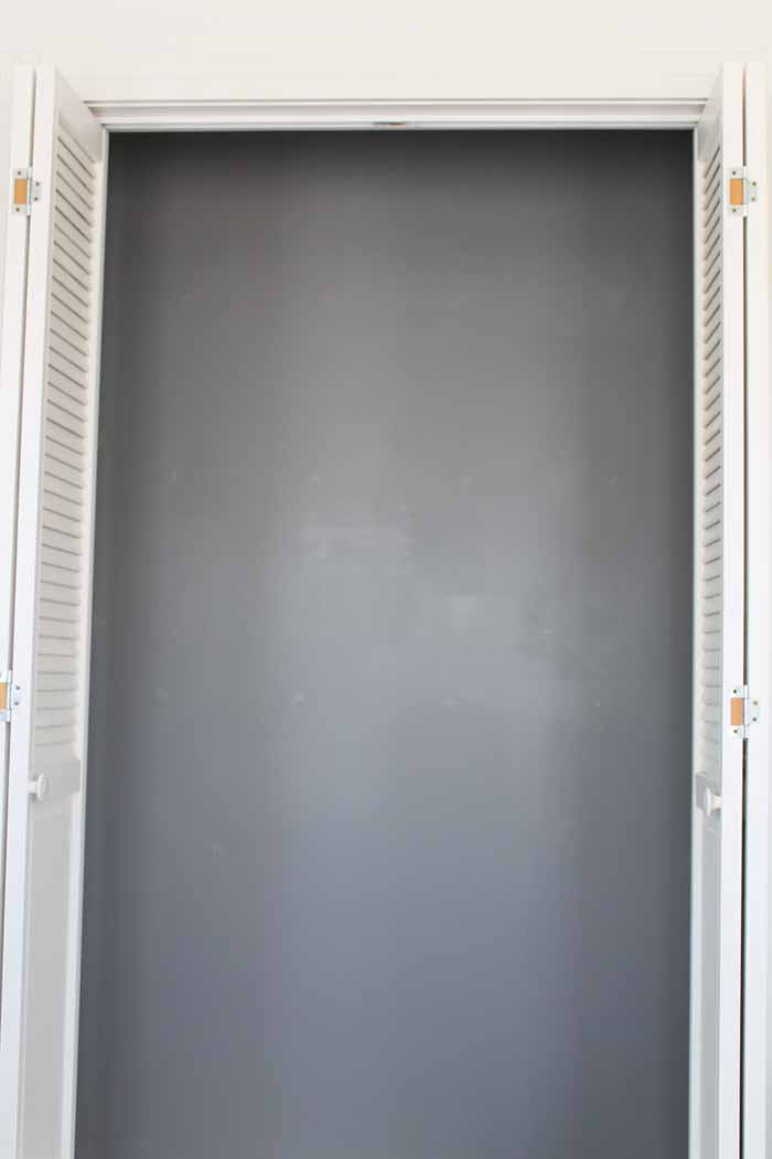 closet with back wall painted grey