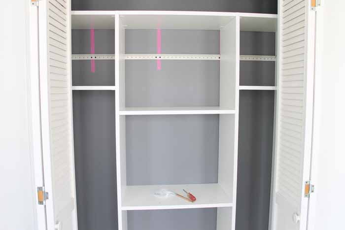 adding closet shelves to a wooden organizer