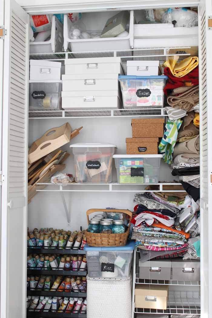 closet filled with craft supplies on wire shelves