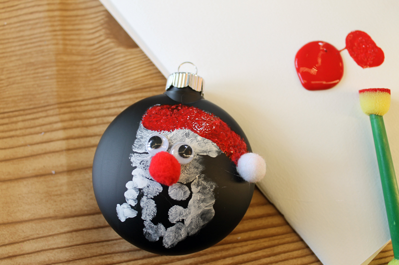 This handprint ornament is an easy to make craft with the kids for the holidays. Perfect for toddlers, infants, and more!