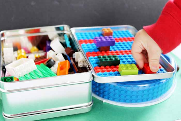 Make a Lego travel case! You can make this in minutes and give as a cute holiday gift idea!