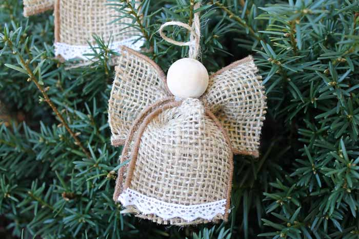 Close-up of one homemade burlap angel ornament hanging on a tree