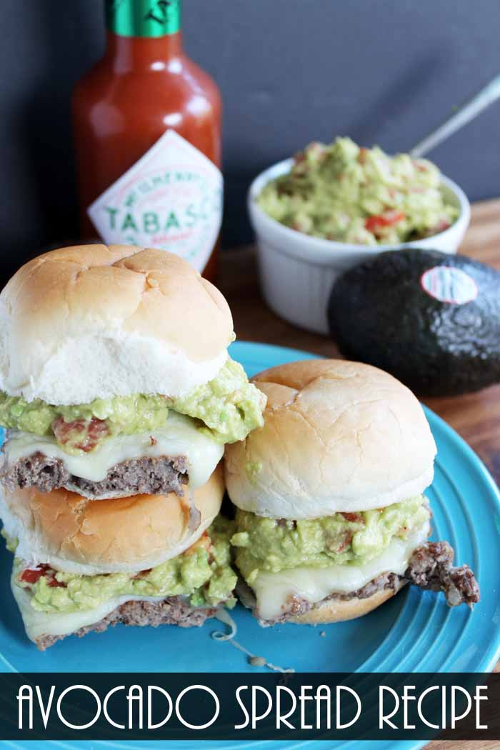 This avocado spread recipe is perfect for big game day! Use it as a spread on these taco burgers, hot dogs, and so much more!
