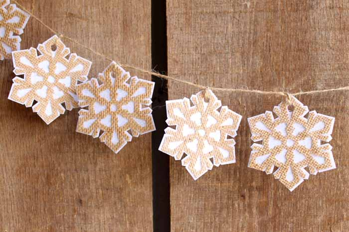Make this burlap garland for your winter decor! A farmhouse style garland that is easy to make with the Cricut Maker!