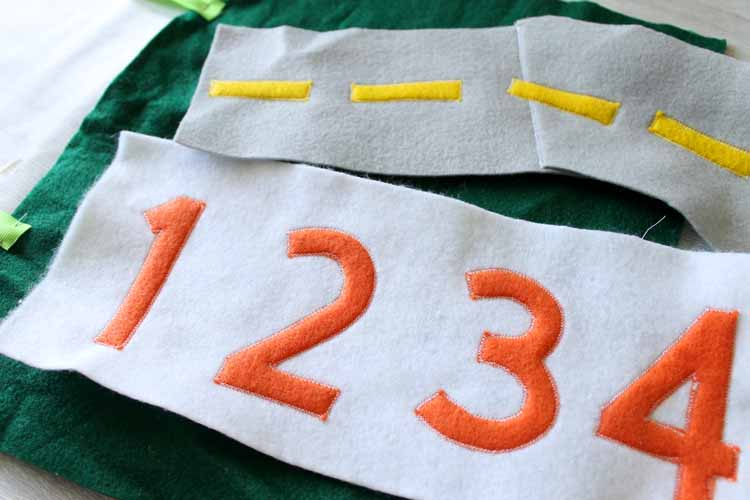 sewing around numbers on felt