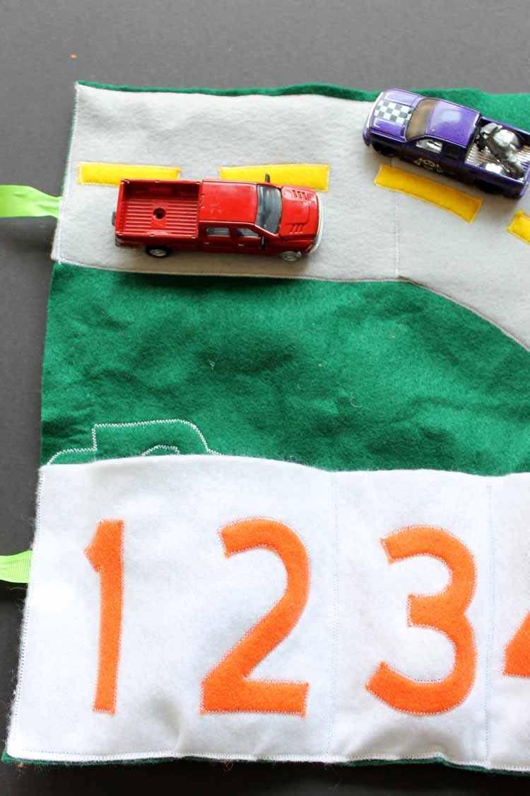 cars on a felt play mat