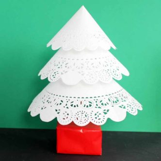 Make this paper Christmas tree from paper doilies! A quick and easy holiday decor project that is perfect for parties!