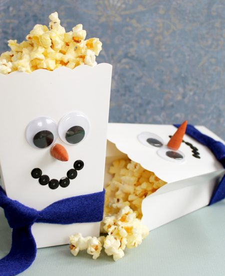 snowman popcorn box on a table