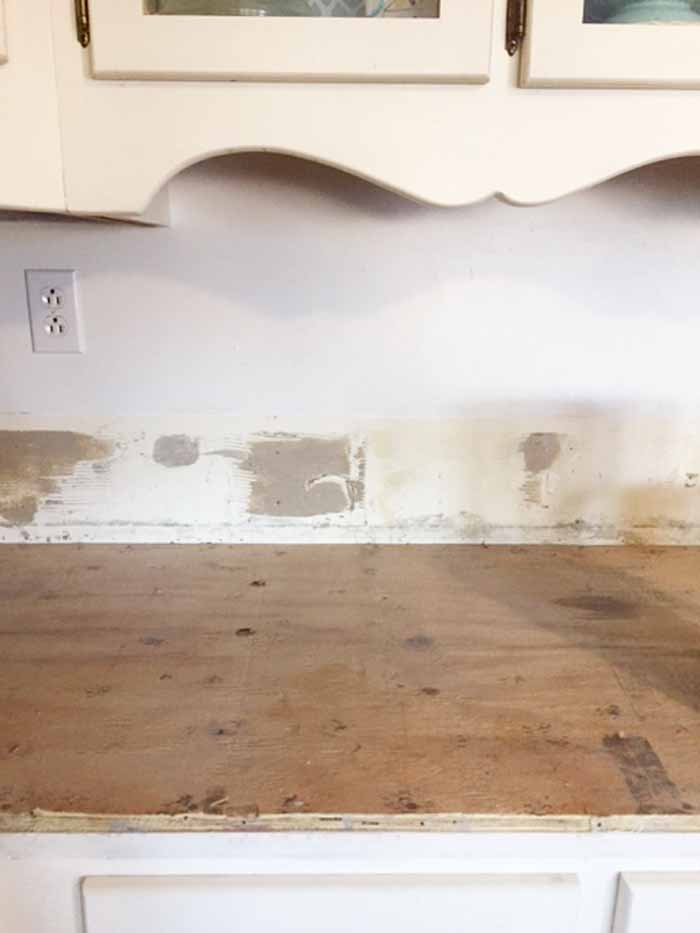 Tile removal of kitchen counters with thick set mortar layer.
