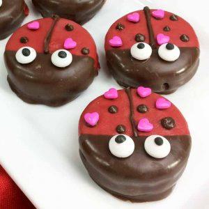 ladybug heart cookies on a plate