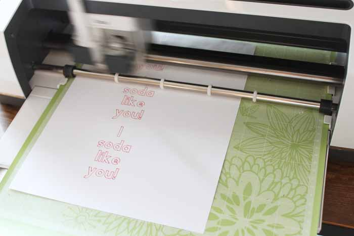 top shot of cheesy valentines being printed from Cricut machine