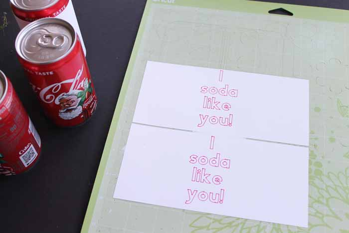 top shot of white paper with i soda like you printed on them