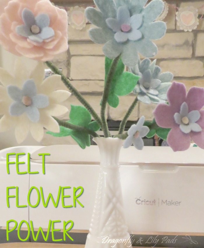 felt flowers on branches in a vase