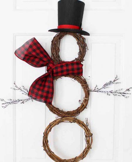 snowman wreath hanging on a door