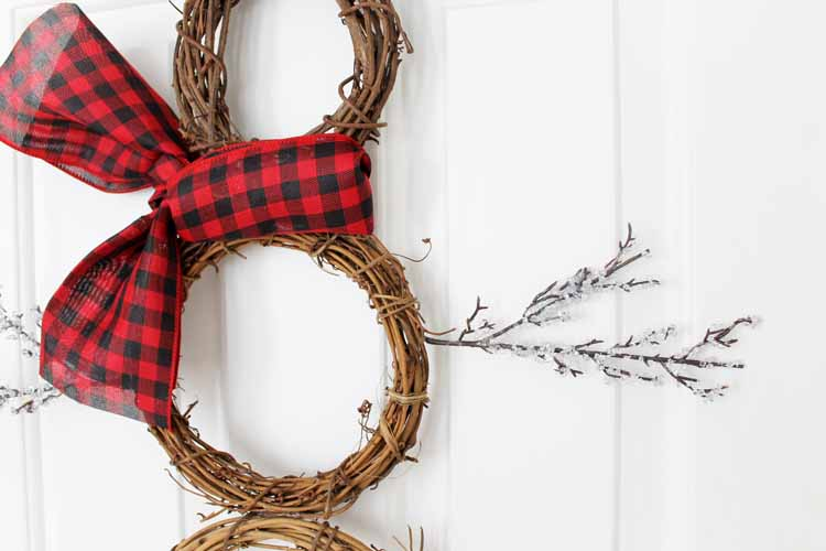 This snowman wreath is perfect for winter! Make it for Christmas and leave it up until spring!