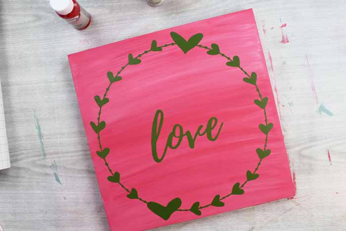 love and heart wreath in vinyl on a wood panel