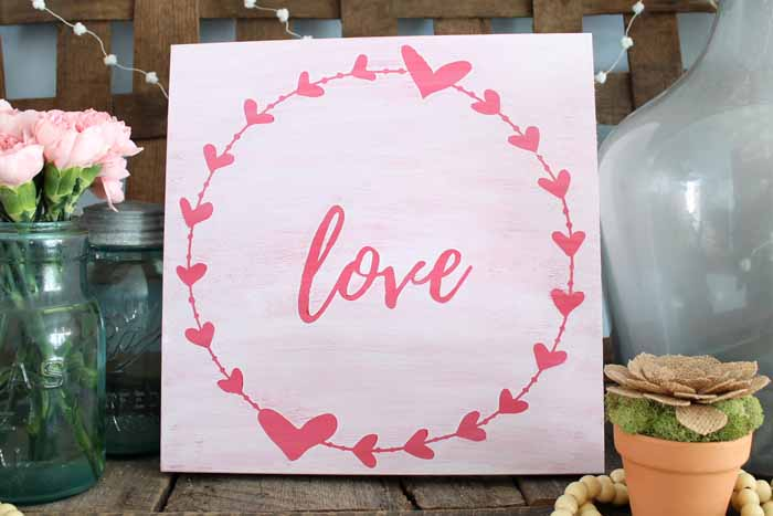 rustic love wall art on a mantel