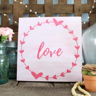 Make this DIY love wall art with your Cricut machine in minutes! A quick and easy farmhouse style sign for Valentine's Day!