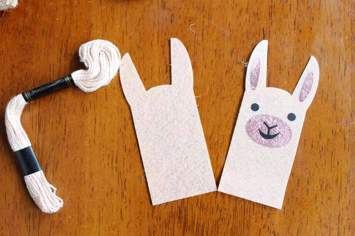 front and back llama pieces with embroidery floss