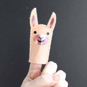 Make a smiling llama finger puppet for your little one! A quick and easy project with your Cricut machine!