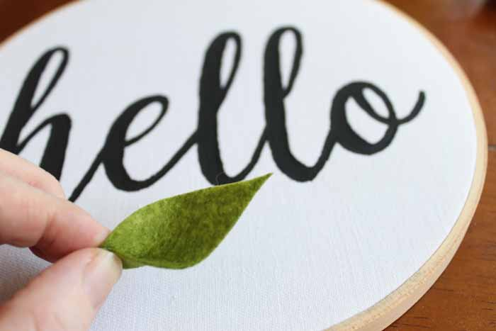 hello wall craft in embroidery hoop with a felt leaf