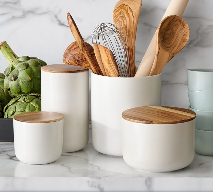 white canisters with wood lids