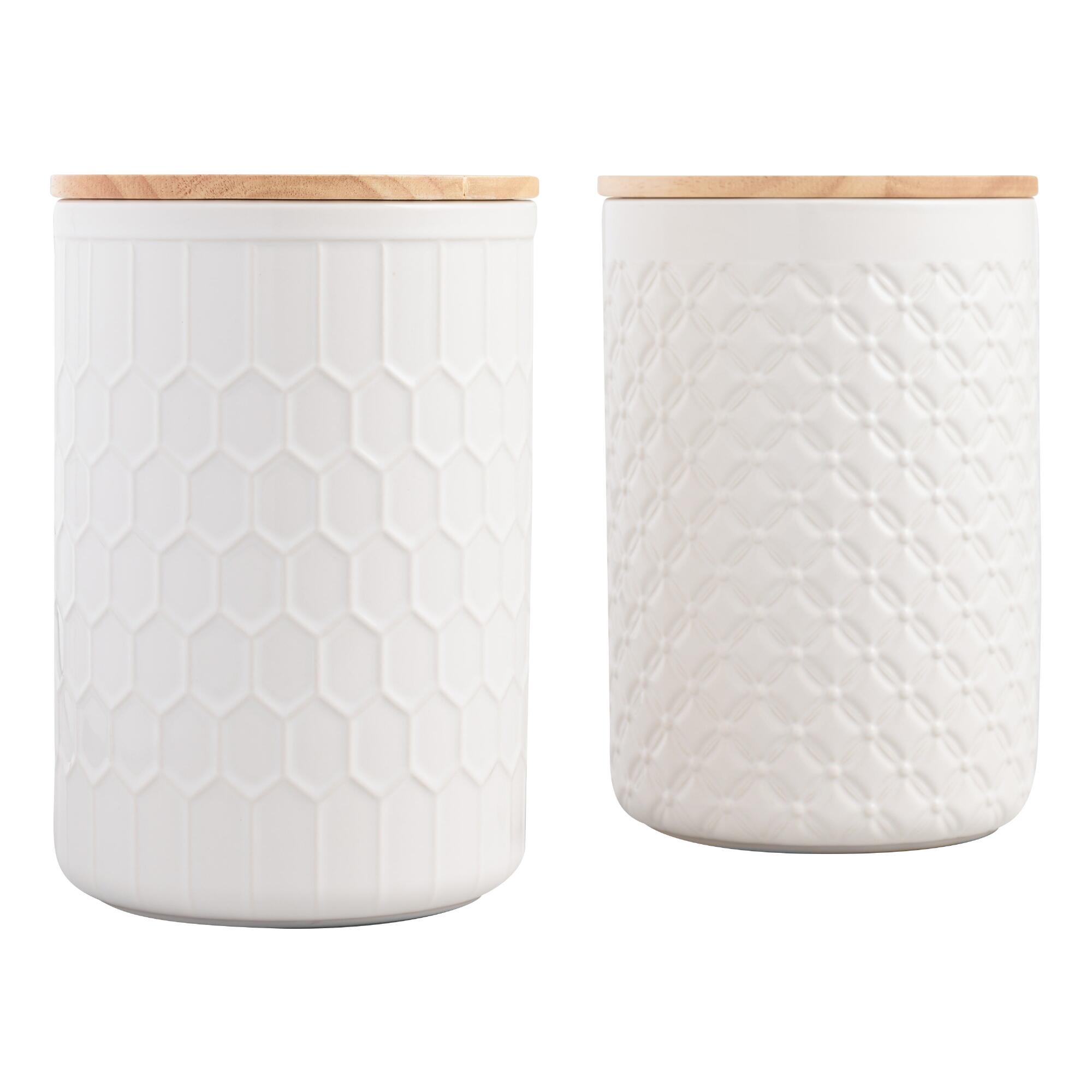 white textured canisters