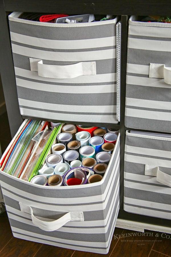 fabric bins holding craft supplies
