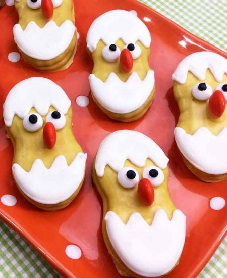 tray of cookies that look like chicks in eggs
