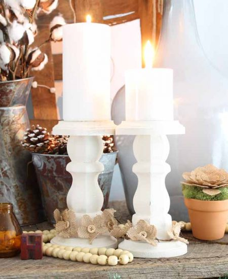 wooden candlesticks on a farmhouse mantel