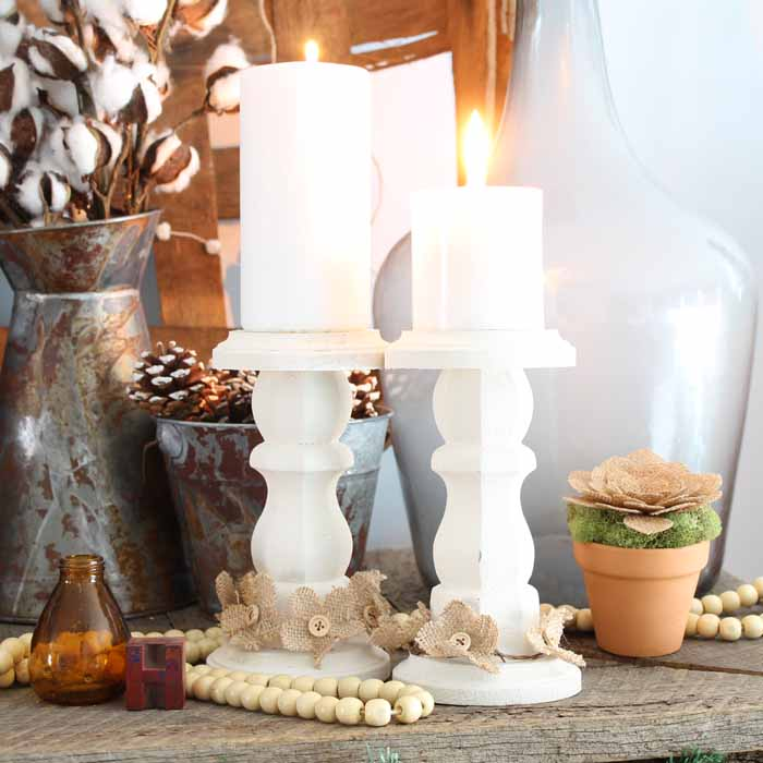 wooden candlesticks on a farmhouse mantel