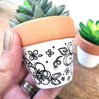 clay pot with doodles