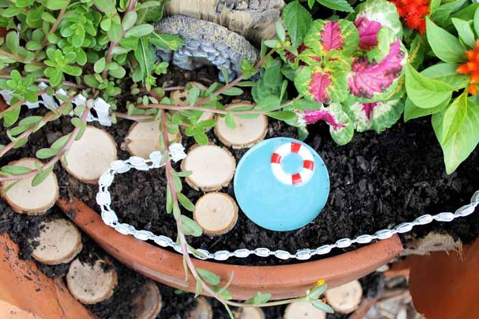 adding a pool to a fairy garden in a clay pot