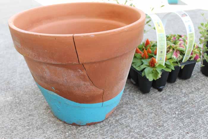 broken clay pot to turn into a fairy garden