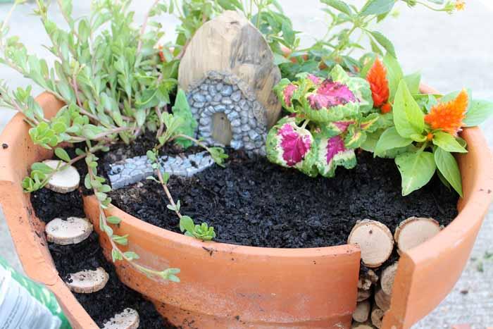 adding flowers and a fairy garden door
