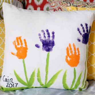 Try these Mother's Day ideas! A quick and easy handprint pillow that preschoolers and toddlers can make for mom in minutes!