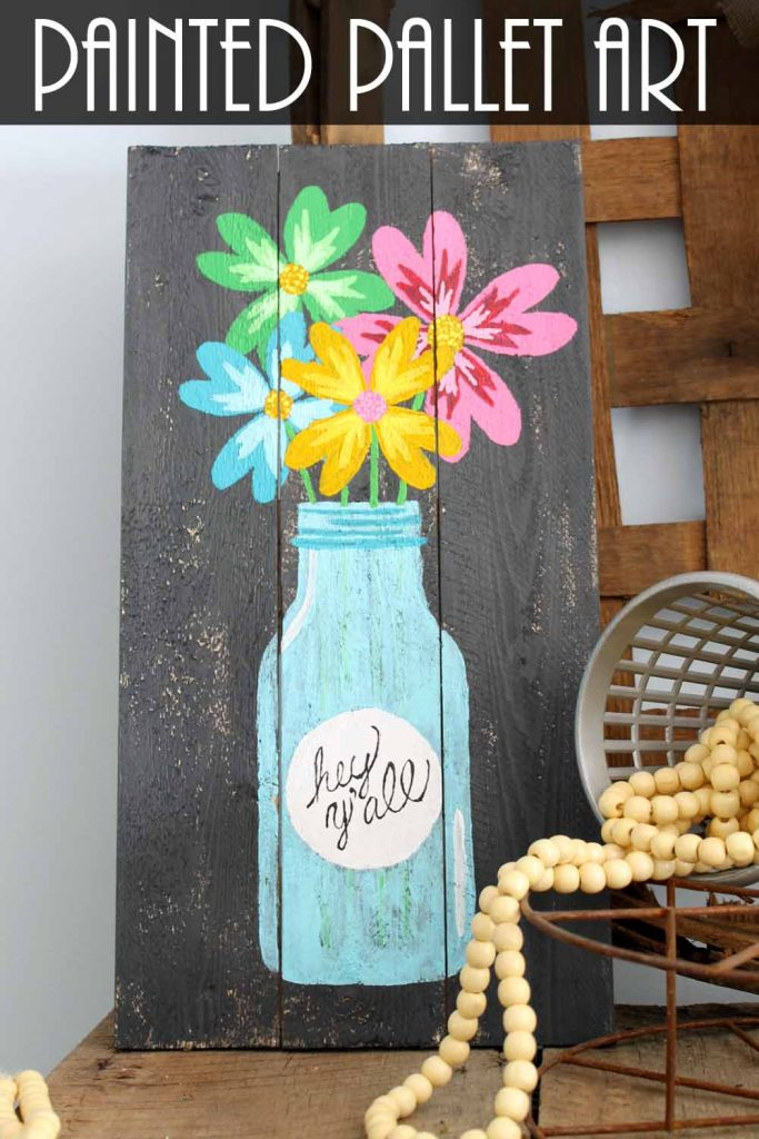 painted pallet art with a jar and flowers
