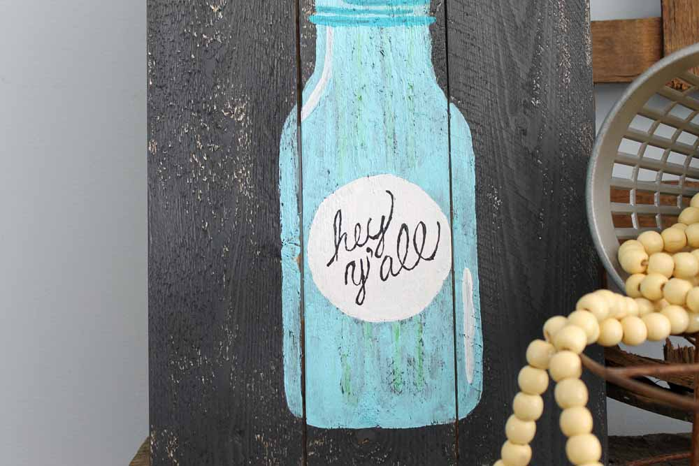 Painted pallet mason jar art that you can make! Easy step by step instructions for creating your own!