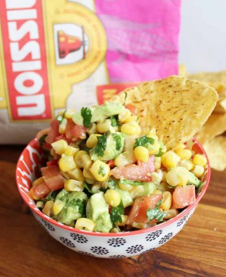 Make some sweet corn salsa with avocado! Serve this up for Cinco de Mayo with either chips or as a tasty topping for tacos! #recipe #cincodemayo #salsa #avocado