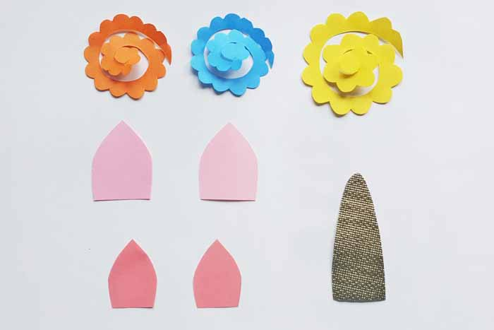 Create the flowers, ears, and horn for your unicorn party bags.