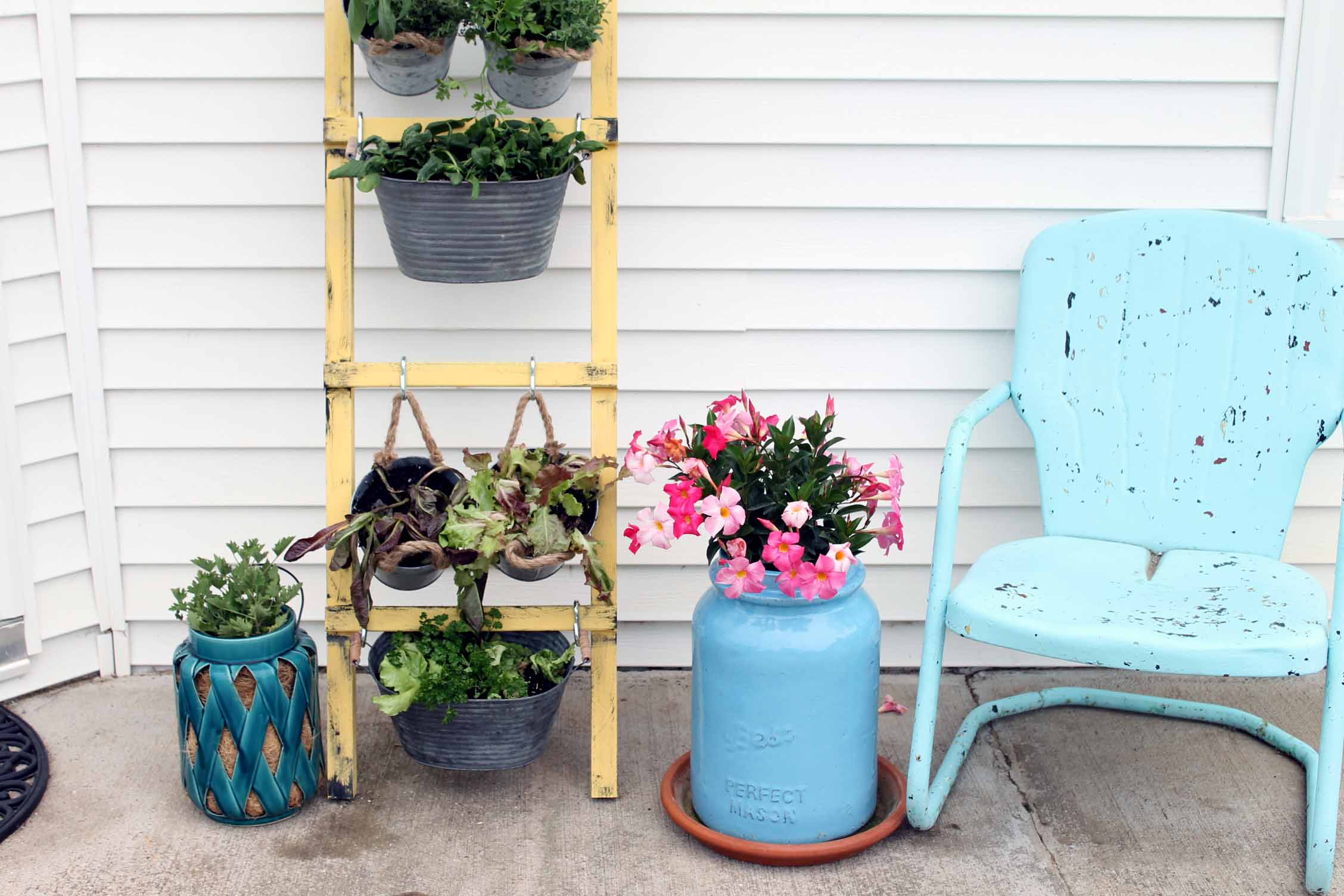 Add this DIY vertical garden to your porch this spring and summer! The perfect way to go vegetables and herbs in a small space!