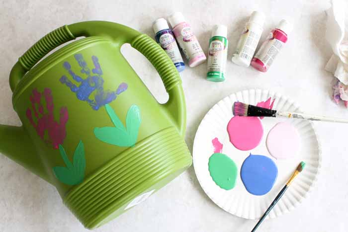 making handprint flowers on a watering can