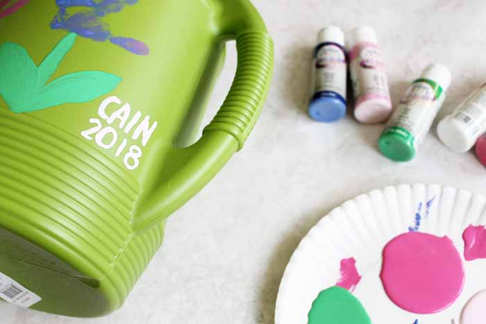 Add handprint flowers to a watering can for a one of a kind Mother's Day gift idea! Perfect easy craft for infants and toddlers to give mom! #mothersday #kidscrafts #gift #giftidea