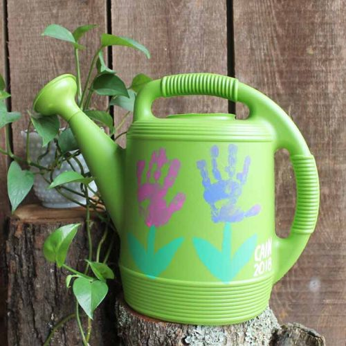 handprint flowers watering can on a stump