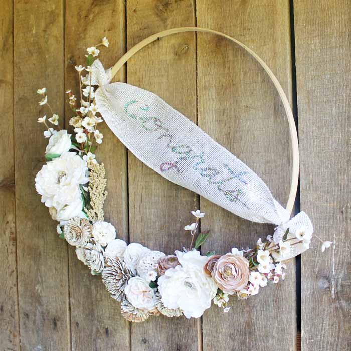 Make a hoop wreath for any party that you are hosting! An easy craft idea with your Cricut Wisteria Explore Air 2 machine! Get instructions as well as a cut file!