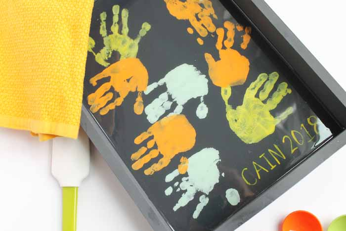 Make this toddler gift for mom in just a few minutes! She will love these sweet hand prints added to a tray for Mother's Day!