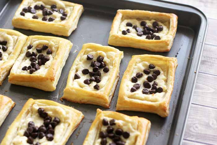 Baking a cream cheese danish. You will love the addition of chocolate chips!