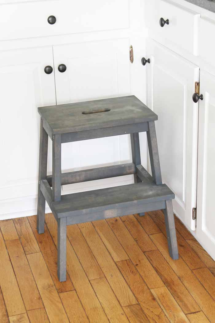 An Ikea stool in a farm kitchen with grey stain.