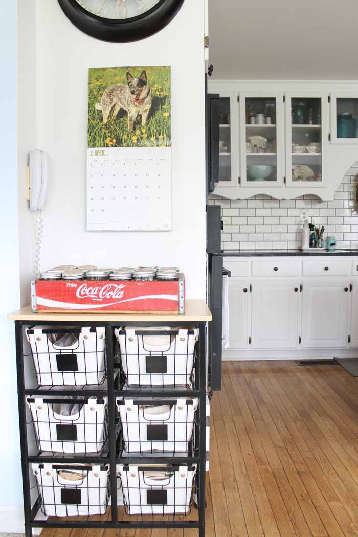A rolling cart organizer in a farm kitchen for cook books and more!